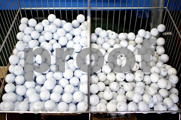 Beck Diefenbach  -  bdiefenbach@daily-chronicle.com<br /> <br /> Golf balls for sale at Diamond Tour Golf shop in downtown DeKalb on Thursday June 10, 2010. Originally an online and phone orders-only company, Diamond Tour Golf recently opened a store front.