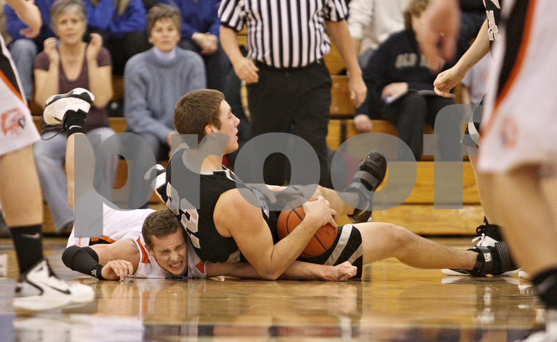 Rob Winner – rwinner@daily-chronicle.com<br /> <br /> Sandwich guard PJ Crotty (left) and Kaneland forward Tyler Callaghan struggle for a loose ball under the Indians' basket during the second quarter of the fifth place game at the Plano Christmas Classic in Plano, Ill. on Thursday, December 30, 2010. Sandwich defeated Kaneland, 42-40.