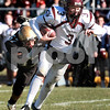 Kyle Bursaw - kbursaw@daily-chronicle.com<br /> <br /> Montini Quarterback Matt Westerkamp evades Sycamore Spartans' Sam Capello in the first quarter in Sycamore, Ill. on Nov. 6., 2010. The Montini Broncos defeated the Sycamore Spartans 28-7.