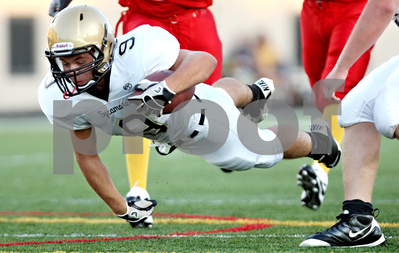 Rob Winner - rwinner@daily-chronicle.com<br /> <br /> Sycamore's Tommy Nice dives forward after being hit for some extra yardage during the first quarter of their game against North Lawndale at Lane Stadium in Chicago, Ill. on Saturday August 28, 2010.