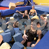 Kyle Bursaw – kbursaw@daily-chronicle.com<br /> <br /> DeKalb gymnastics team members fluff a pit for practicing at Energym in Sycamore, Ill. on Tuesday, Dec. 21, 2010. The pit allows them to try new techniques with a soft place to land.