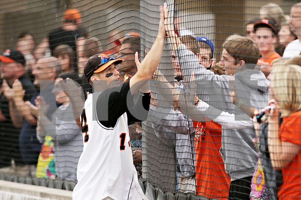 Rob Winner – rwinner@daily-chronicle.com<br /> <br /> Frank Petras celebrates with the DeKalb fans after the IHSA Class 3A Augustana College Super-Sectional on Monday June 7, 2010. DeKalb defeated Galesburg, 8-4.