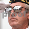 Kyle Bursaw — kbursaw@daily-chronicle.com<br /> <br /> Steve Marberry salutes a line of fellow veterans reflected in his sunglasses, all of whom were participating in a Veteran's Day ceremony at Memorial Park at the intersection of 1st Street and Lincoln Highway in DeKalb, Ill. on Nov. 11, 2010.