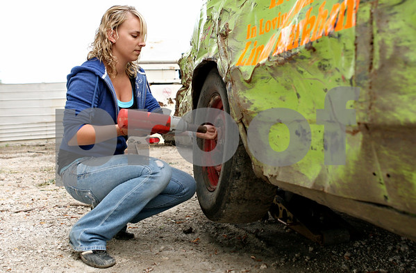 Rob Winner – rwinner@daily-chronicle.com<br /> <br /> Powder puff race car driver Danielle Heath, of Rolling Meadows, removes a tire from 1986 Chevrolet Caprice at Sycamore Speedway in Maple Park, Ill. on Friday July 30, 2010.