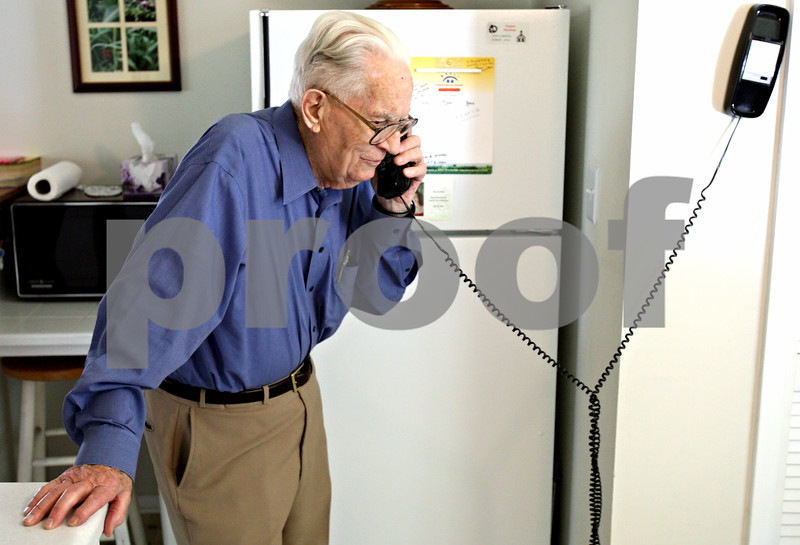 Rob Winner – rwinner@daily-chronicle.com<br /> <br /> Ivan Williams, 88, receives a phone call from his youngest daughter at his home in DeKalb, Ill. on Friday August 20, 2010. Williams, who is a long-time DeKalb resident, lives by himself and has made changes to the home that he originally built 1957 to meet his needs as he ages.