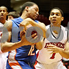 Rob Winner – rwinner@daily-chronicle.com<br /> <br /> Boise State guard La'Shard Anderson (12) is fouled by Northern Illinois forward Bryan Hall while fighting for possession during the first half in DeKalb, Ill. on Monday November 29, 2010.