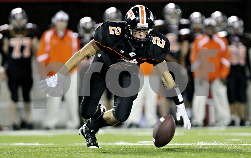 Rob Winner  -  rwinner@daily-chronicle.com<br /> <br /> DeKalb's Robbie Miller goes to the turf to control a squib kick during the second quarter in DeKalb, Ill. on Friday September 10, 2010.