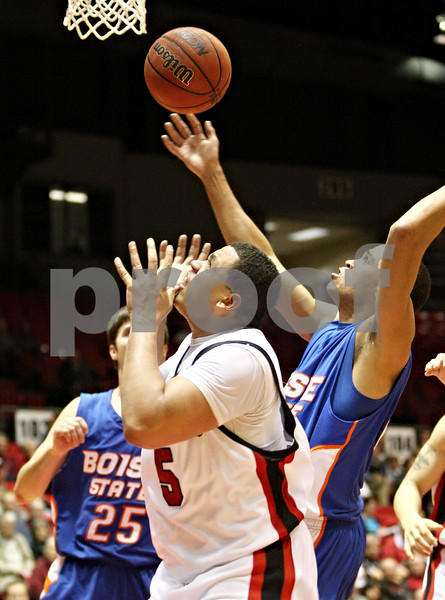 Rob Winner – rwinner@daily-chronicle.com<br /> <br /> Northern Illinois forward Tim Toler (5) is unable to control a loose ball under the Huskies' basket during the first half in DeKalb, Ill. on Monday November 29, 2010.