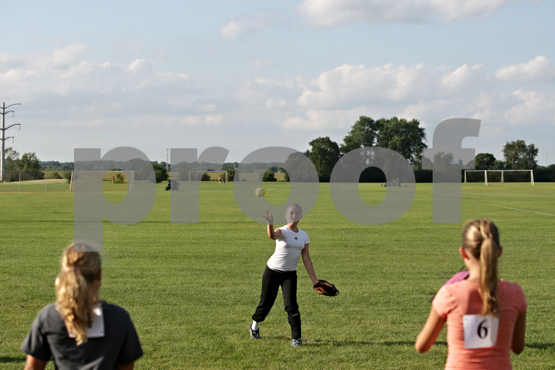 Beck Diefenbach  -  bdiefenbach@daily-chronicle.com<br /> <br /> Natilee Morey (center) throws the ball during tryouts for a new 14U travel fastpitch softball team called Sycamore Flash, at the Sycamore High School softball field in Sycamore, Ill., on Wednesday July 28, 2010.