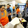 Rob Winner – rwinner@daily-chronicle.com<br /> <br /> Cashier Angel Goggins checks her computer system to confirm that Vincent Neao-Luckett should be receiving a school lunch at DeKalb High School in DeKalb, Ill. on Thursday September 23, 2010.