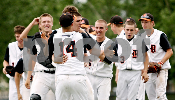 Rob Winner – rwinner@daily-chronicle.com<br /> <br /> The Dekalb baseball team celebrates their IHSA Class 3A DeKalb Sectional championship on Saturday June 5, 2010 in Dekalb, Ill.