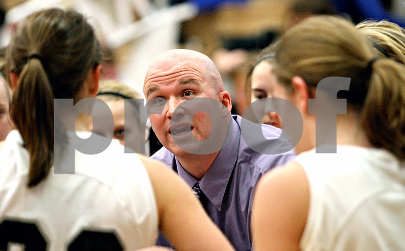 Rob Winner – rwinner@daily-chronicle.com<br /> Kaneland coach Ernie Colombe calls a time-out before the end of the first half during their game against Sycamore in Maple Park, Ill. on Saturday February 6, 2010. Sycamore defeated Kaneland, 43-39.