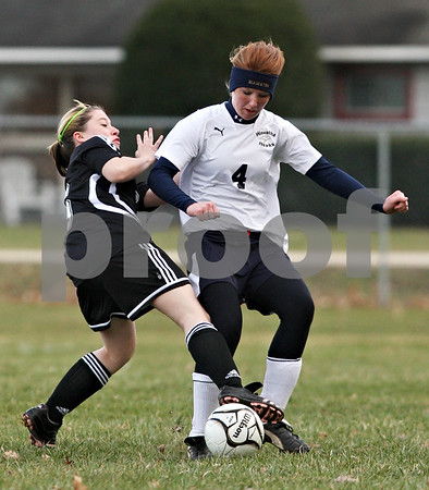 Beck Diefenbach  -  bdiefenbach@daily-chronicle.com<br /> <br /> Indian Creek's Sandra Martinez (6, left) trips over Hiawatha's Diana Sanderson (4) while fighting for the ball during the first half of the game at Hiawatha High School in Kirkland, Ill., on Thursday March 25, 2010.