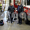 Rob Winner – rwinner@daily-chronicle.com<br /> Firefighter Tom Conley (left) and fire Capt. Kevin McCauley talk for a moment as the two prepare for their day at fire station one in DeKalb, Ill. on Friday February 26, 2010.
