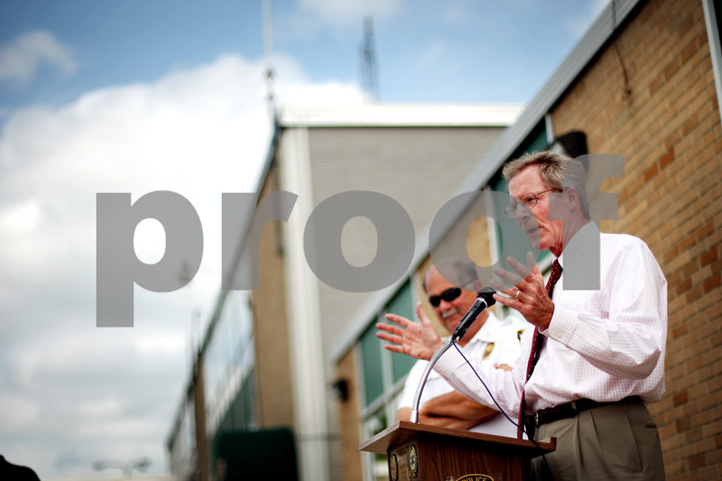 Beck Diefenbach  -  bdiefenbach@daily-chronicle.com<br /> <br /> Sycamore city manager Bill Nicklas, right, speaks to members of local government and police department before the formal ground breaking for the new Sycamore Police Department building on Wednesday June 23, 2010.