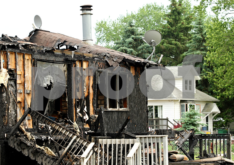 Beck Diefenbach  -  bdiefenbach@daily-chronicle.com<br /> <br /> Partially destroyed by a late night fire, a house at 1013 Thurlby Road in Kingston sits empty on Tuesday May 25, 2010.