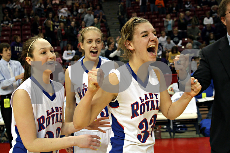 Beck Diefenbach - bdiefenbach@daily-chronicle.com<br /> <br /> Hinckley-Big Rock's Tess Godhardt (right), Jessica Leifheit (center) and Alyssa Baunach rejoice after defeating Ridgewood to win the IHSA Class 1A semifinal game at the Red Bird Arena on the campus of Illinois State University in Bloomington, Ill., on Friday Feb. 26, 2010.