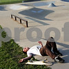 Beck Diefenbach  -  bdiefenbach@daily-chronicle.com<br /> <br /> Pat Buckley, 22, of DeKalb, laughs after falling off his skateboard at the skate park in Katz Park in DeKalb, Ill., on Wednesday July 14, 2010.