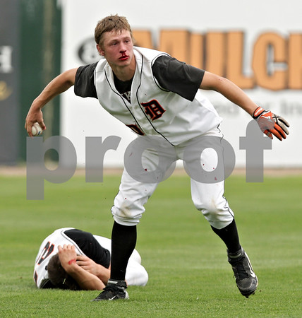 Beck Diefenbach  -  bdiefenbach@daily-chronicle.com<br /> <br /> DeKalb's Jake Gordon (front) throws the ball as Brian Sisler (back) lies on the ground after they collided during the first inning of the IHSA Class 3A State Semifinal Game against Marian Central in Joliet, Ill., on Friday June 11, 2010.