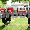 Beck Diefenbach  -  bdiefenbach@daily-chronicle.com<br /> <br /> Soon to be graduates Liz Apollinari (far left) and Jessica Altersohn (third from left) have their picture taken with biology professor Ken Gasser by friend Abbey Poyner (far right)  following a fire on the fourth floor of the Montgomery Building on the campus of Northern Illinois University in DeKalb, Ill., on Thursday May 6, 2010.