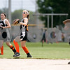 Rob Winner – rwinner@daily-chronicle.com<br /> <br /> With runners on base, DeKalb Hurricanes center fielder Rachael Johnson runs in a ball after catching a fly ball during their 14U bracket game against the Kishwaukee Valley Storm at the Storm Dayz softball tournament on Saturday June 26, 2010 in Sycamore, Ill.