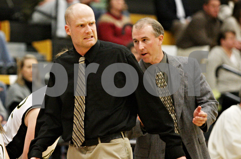 Rob Winner – rwinner@daily-chronicle.com<br /> <br /> Sycamore coach Ryan Picolotti paces along the court during the first quarter on Friday December 10, 2010 in Sycamore, Ill.