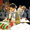 Rob Winner – rwinner@daily-chronicle.com<br /> <br /> First year volunteer Brenna Hale of DeKalb wraps a gift at Blumen Gardens in Sycamore on Tuesday night. The gifts will be delivered to needy families by the Goodfellows on Friday morning. Goodfellows is a volunteer group that delivers gifts to the needy during the holidays.