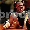 Beck Diefenbach  -  bdiefenbach@daily-chronicle.com<br /> <br /> DeKalb's Colton Phelps struggles to stay up during the 140 pound match against Sandwich's James Cox at DeKalb High School in DeKalb, Ill., on Thursday Jan. 28, 2010. Phelps lost to Cox, but DeKalb was able to come back and defeat Sandwich 37 to 27.