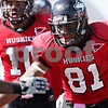 Rob Winner - rwinner@daily-chronicle.com<br /> <br /> Northern Illinois wide receiver Nathan Palmer celebrates his touchdown reception in the third quarter in DeKalb, Ill. on Saturday October 9, 2010. The Huskies went on to defeat Temple, 31-17.