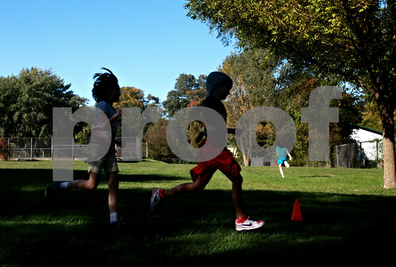 Beck Diefenbach – bdiefenbach@daily-chronicle.com<br /> <br /> Girls run laps during the Girls on the Run program at West Elementary School in Sycamore, Ill., on Tuesday Oct. 5, 2010.