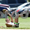 Rob Winner – rwinner@daily-chronicle.com<br /> <br /> Kishwaukee Valley Storm left fielder Sabrina Killeen makes a diving catch in the second inning of their game against the McHenry County Heatwave Black  during their 16U bracket game of the Storm Dayz softball tournament on Saturday June 26, 2010 in Sycamore, Ill.
