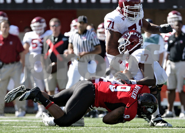 Rob Winner - rwinner@daily-chronicle.com<br /> <br /> Northern Illinois linebacker Devon Butler sacks Temple quarterback Chester Stewart during the third quarter of their game in DeKalb, Ill. on Saturday October 9, 2010. However, Butler removed his helmet before leaving the field and was flagged giving Temple a first down.