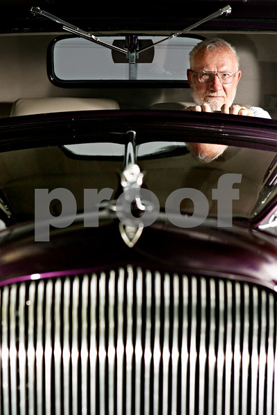 Rob Winner – rwinner@daily-chronicle.com<br /> <br /> Kirkland resident John Pierce, who is a member of the Turning Back Time Car Club, sits behind the wheel of this 1933 Plymouth PD Coupe on Thursday July 22, 2010.