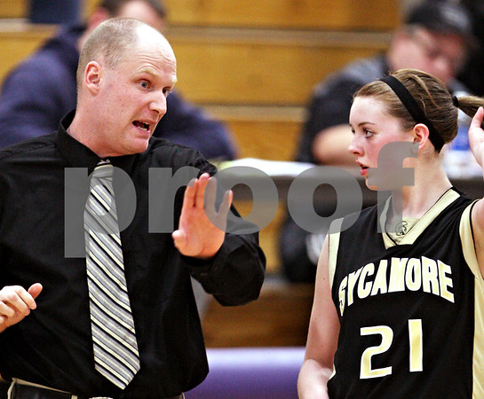 Beck Diefenbach  -  bdiefenbach@daily-chronicle.com<br /> <br /> Sycamore head coach Ryan Picolotti (left) talks with Kate Binder (21, right)during the third quarter of the IHSA Class 3A Regional playoff game against Burlington Central at Rochelle Township High School in Rochelle, Ill, on Monday Feb. 15, 2010.