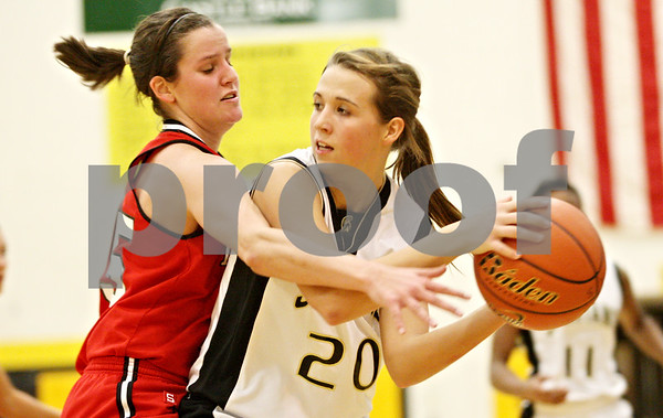 Rob Winner – rwinner@daily-chronicle.com<br /> <br /> Yorkville center Morgan Harrison (left) pressures Sycamore's Ashley Berlinski during the second quarter in Sycamore, Ill. on Tuesday December 7, 2010.