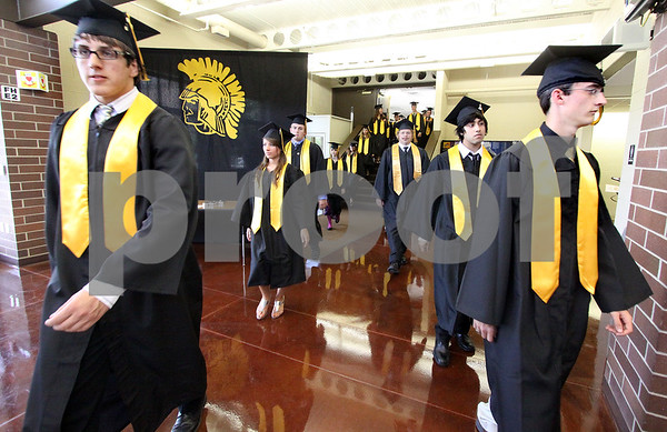 Wendy Kemp/For The Daily Chronicle<br /> The processional during the graduation ceremony at Sycamore High School on Sunday.<br /> Sycamore 5/30/10