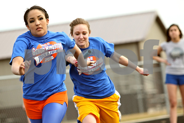 Beck Diefenbach  -  bdiefenbach@daily-chronicle.com<br /> <br /> Genoa-Kingston's Dakota Chandler (left) receives the baton from teammate Sam Kottmeier during track practice at Genoa-Kingston High School in Genoa, Ill., on Tuesday March 16, 2010.