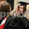 Wendy Kemp/For The Daily Chronicle<br /> Teacher Sue Purdom helps graduate Tanya Lynch with her cap before the graduation ceremony at Sycamore High School on Sunday.<br /> Sycamore 5/30/10