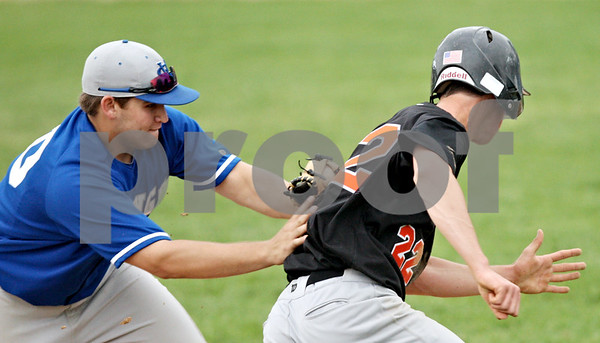 Beck Diefenbach  -  bdiefenbach@daily-chronicle.com<br /> <br /> Geneva's Alex Sroka (20, left) tags out DeKalb's Brian Sisler (22) during the seventh inning of the game at Geneva High School in Geneva, Ill., on Thursday May 13, 2010. DeKalb defeated Geneva 5 to 3.