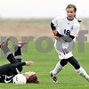 Beck Diefenbach  -  bdiefenbach@daily-chronicle.com<br /> <br /> Indian Creek's Samantha Meredith (7, left) falls on the ground as Kaneland's Amy Fabrizius (18) takes control of the ball during the first half of the game at Kaneland High School in Maple Park, Ill., on Wednesday April 7, 2010. Kaneland defeated Indian Creek 7 to 0.