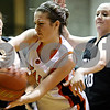 Rob Winner – rwinner@daily-chronicle.com<br /> Kaneland's Nicki Ott (left) and McKinzie Mangers (right) pressure DeKalb's Shelby Wood during the third quarter of their game in DeKalb on Friday January 22, 2010.