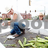 Rob Winner – rwinner@daily-chronicle.com<br /> <br /> Matt Holliday (left) and Adam Lahey, both of Sycamore, sell sweet corn from the back of a pickup truck for Deutsch Farms at the corner of State and Main streets in Sycamore, Ill. on Wednesday July 28, 2010.