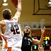 Rob Winner – rwinner@daily-chronicle.com<br /> DeKalb's Jordan Threloff (42) blocks the shot of Sycamore's Luke Johnson during the second quarter. DeKalb went on to defeat Sycamore, 53-43, on Saturday February 20, 2010 in DeKalb, Ill.