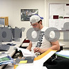 Rob Winner – rwinner@daily-chronicle.com<br /> <br /> Mark Peterson of DeKalb looks over a text book while working on a project for his computer-aided design class on Thursday April 15, 2010 at Kishwaukee College in Malta, Ill. This week is National Design Drafting Week, as proclaimed by the American Design Drafting Association.