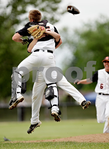Rob Winner – rwinner@daily-chronicle.com<br /> <br /> Catcher Ben Dallesasse (front) jumps into the arms of Jake Lemay after DeKalb defeated Marmion Academy for the IHSA Class 3A DeKalb Sectional championship on Saturday June 5, 2010 in Dekalb, Ill.