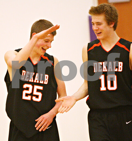 Beck Diefenbach – bdiefenbach@daily-chronicle.com<br /> DeKalb's Pat Rourke (25, left) celebrates with Chris Calbow (10) after defeating Freeport in the IHSA Class 3A semifinal game at Hampshire High School in Hampshire, Ill., on Wednesday March 10, 2010.