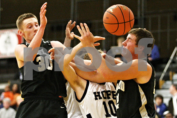 Rob Winner – rwinner@daily-chronicle.com<br /> <br /> (From left to right) Kaneland's Chaon Denlinger, Hope's Ike Muzikowski, and Kaneland's Tyler Callaghan try to control a ball under the Knights' basket during the fourth quarter in Sycamore on Tuesday night. Hope went on to defeat Kaneland, 58-48.