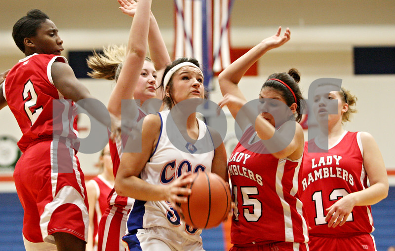 Rob Winner – rwinner@daily-chronicle.com<br /> <br /> Genoa-Kingston forward Alexis Carroll controls a rebound under the Cogs' basket during the second quarter in Genoa on Wednesday night.