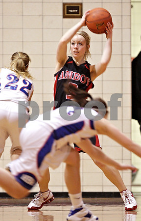 Beck Diefenbach – bdiefenbach@daily-chronicle.com<br /> <br /> Amboy Taylor Corcoran (3) dodges Hinckley-Big Rock's Maxzine Rossler (22, left) and Kaitlin Phillips (14, front)during the first quarter of the IHSA Class 1A Regional Final game at Indian Creek High School in Shabbona, Ill., on Thursday Feb 11, 2010.