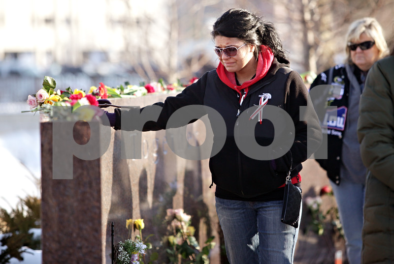 Beck Diefenbach – bdiefenbach@daily-chronicle.com<br /> <br /> A mourner pauses by the memorial following the wreath laying on NIU's campus in DeKalb, Ill., on Sunday Feb. 14, 2010.